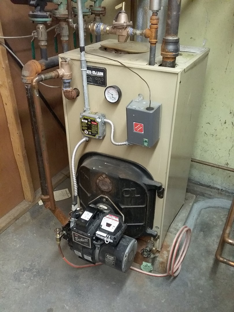 Performed preventive maintenance procedures on weil mclain oil fired boiler
