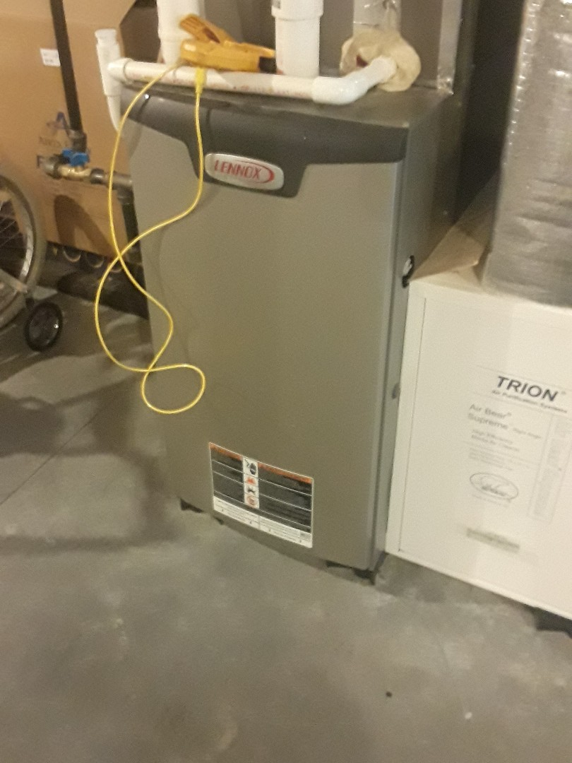 Clean and check Lennoc Gas Heating and AC unit