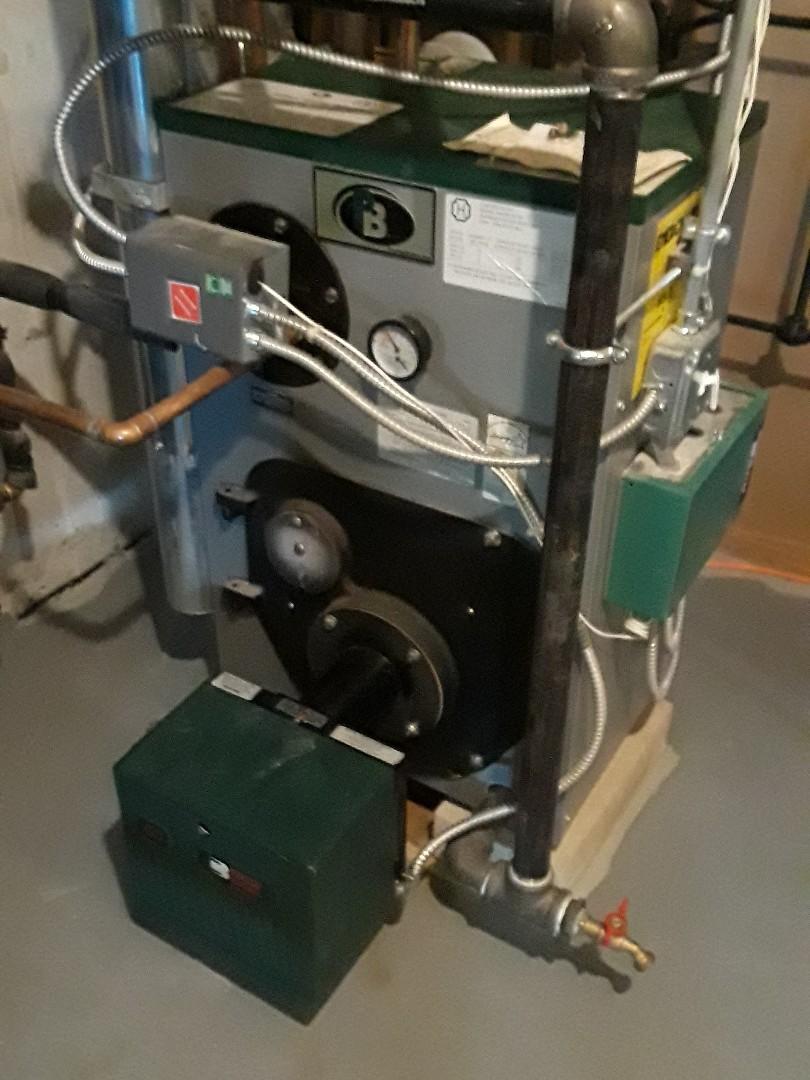 Repair on a Peerless oil boiler