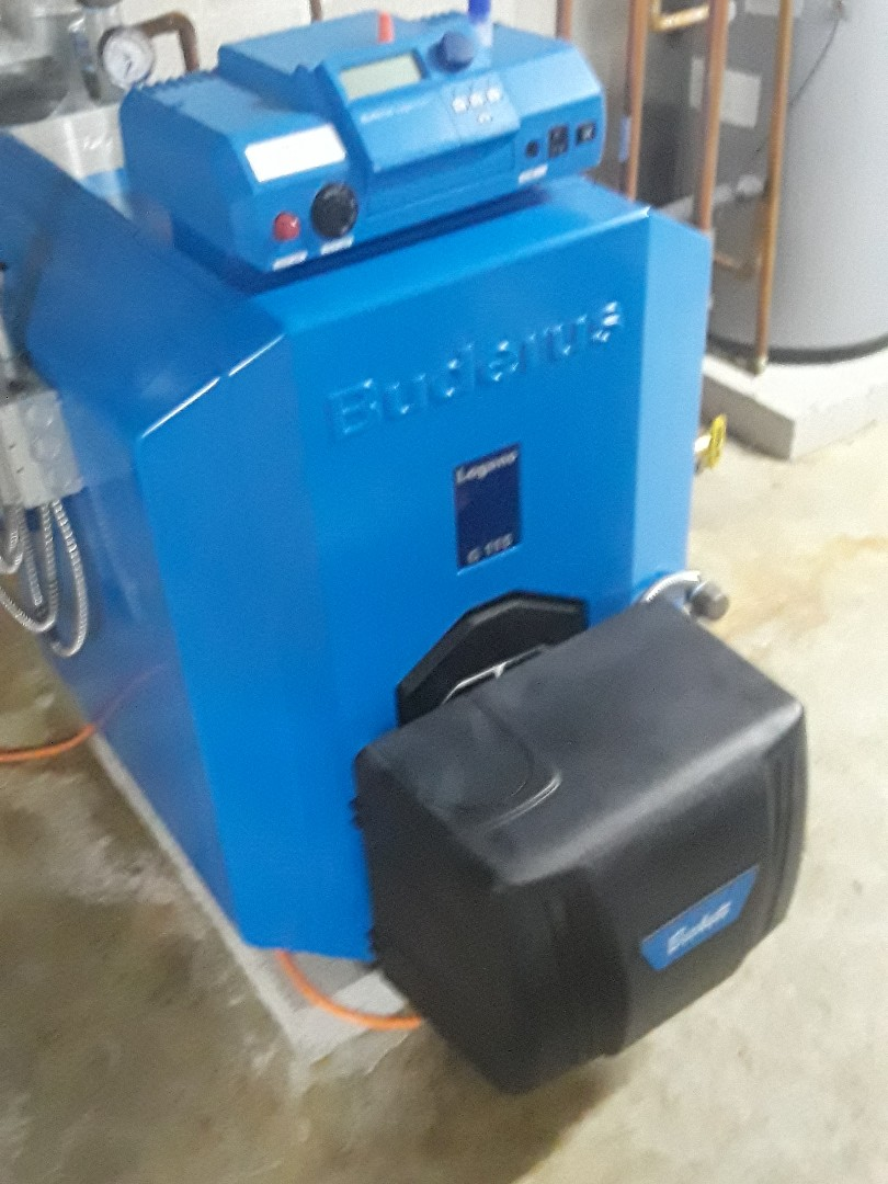 Clean and check Buderus oil heating unit