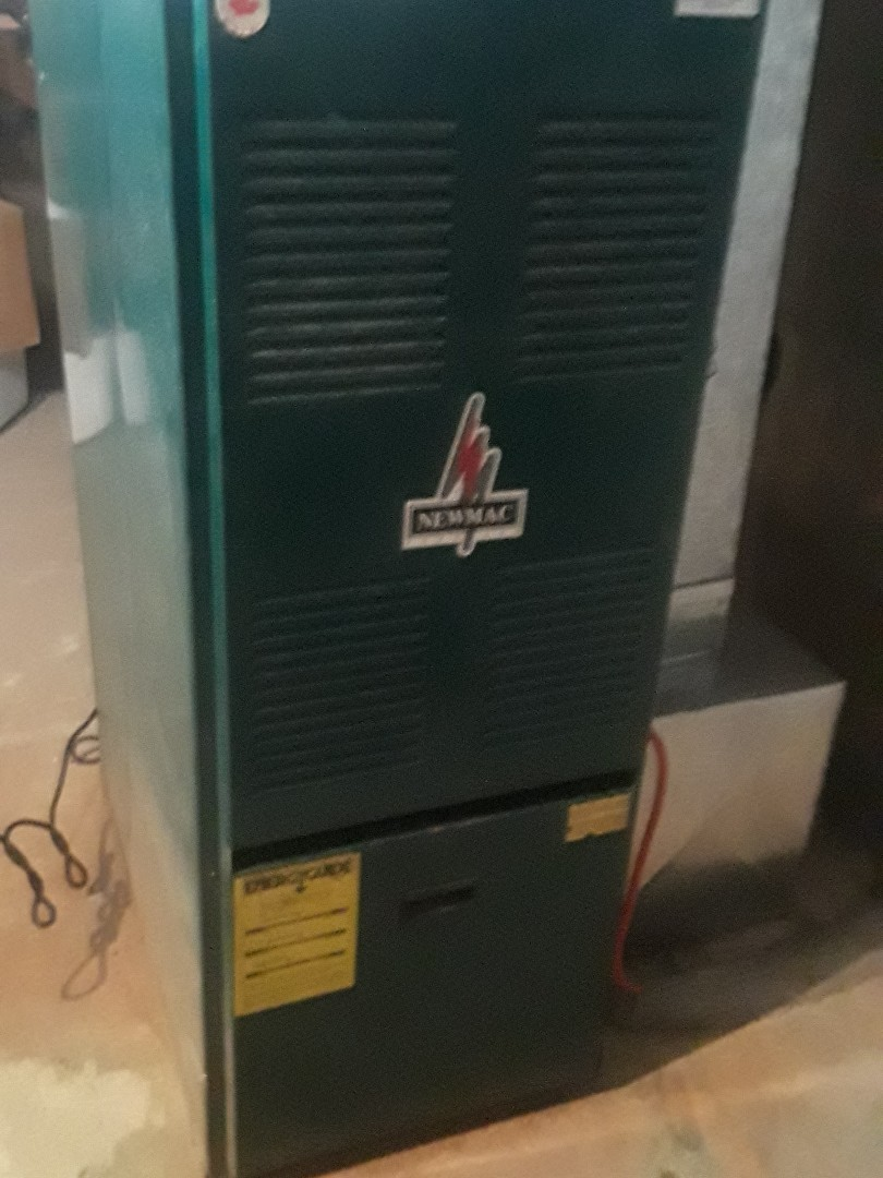 Clean and check Newmac oil heating unit