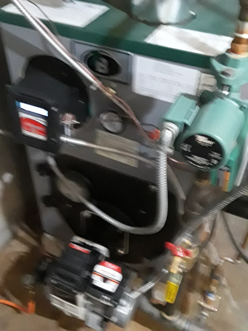 Clean and check Peerless oil boiler