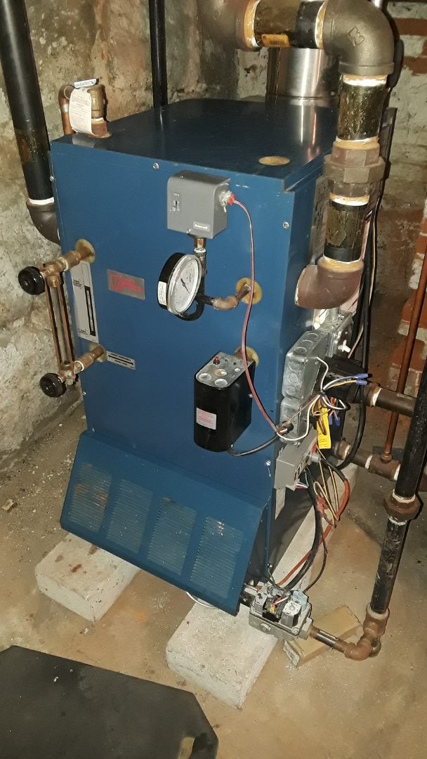 Clean and check Utica Steam gas boiler