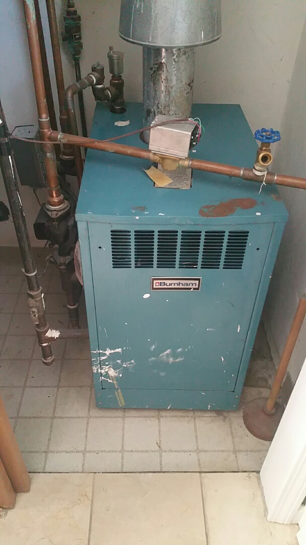 Clinton, MA - Gas heat maintenance call. Performed cleaning and tune up on Burnham gas fired boiler.