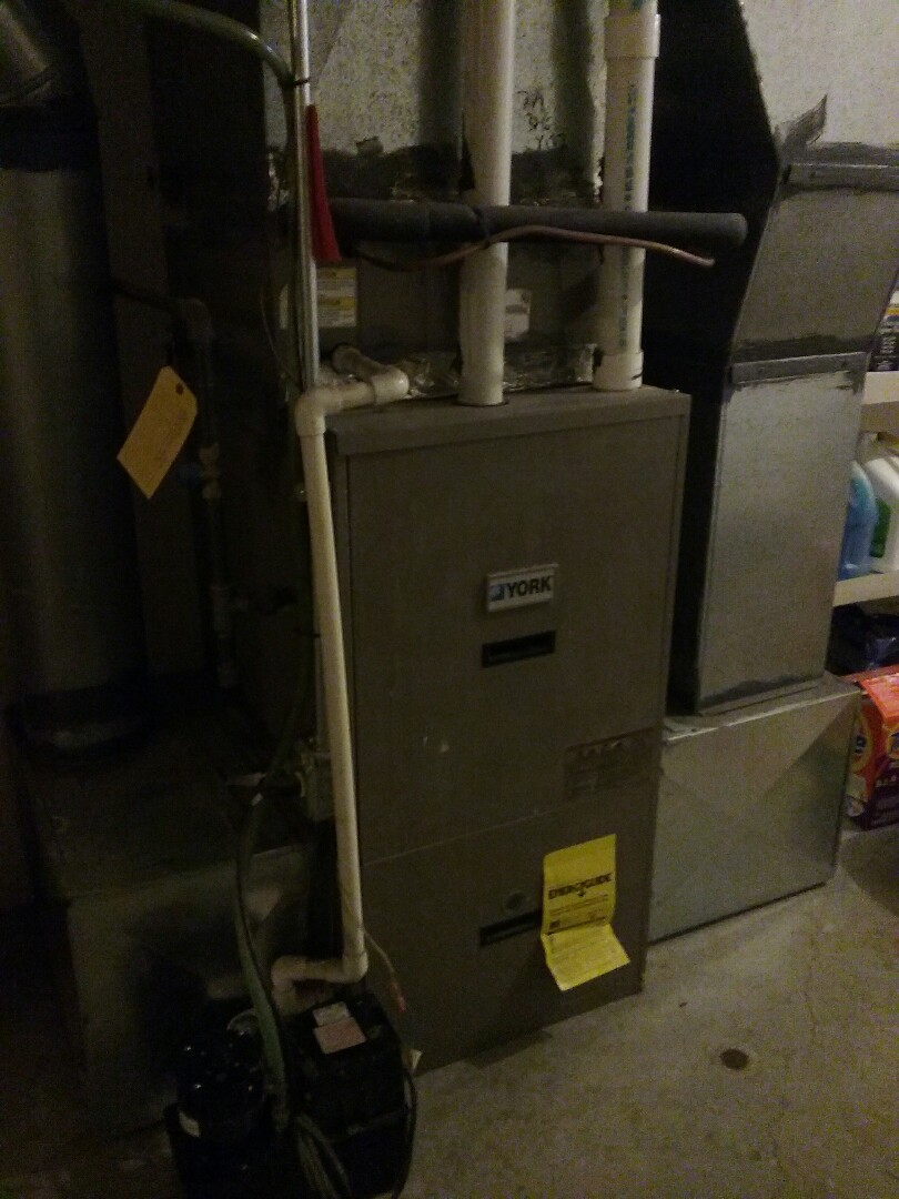 Westborough, MA - Cleaned and checked forced air furnace.