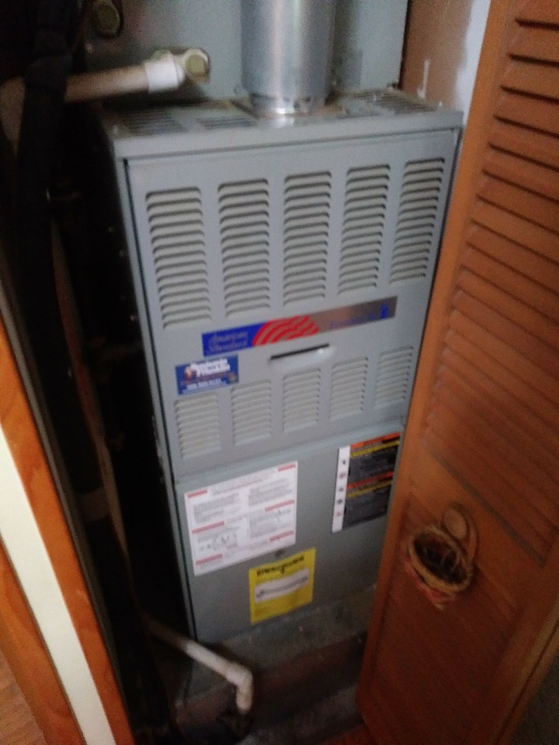Boylston, MA - Performing clean and check on american standard furnace and air conditioning system