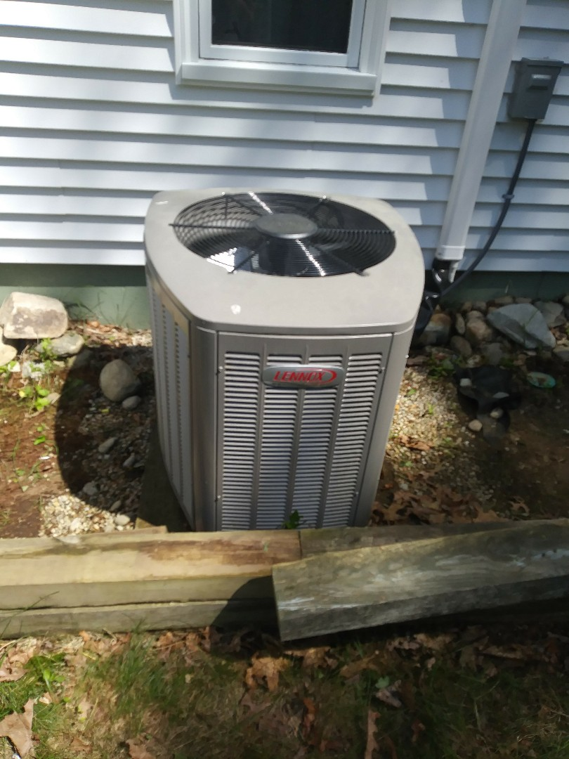Westborough, MA - Performing clean amd check on lennox air conditioning system