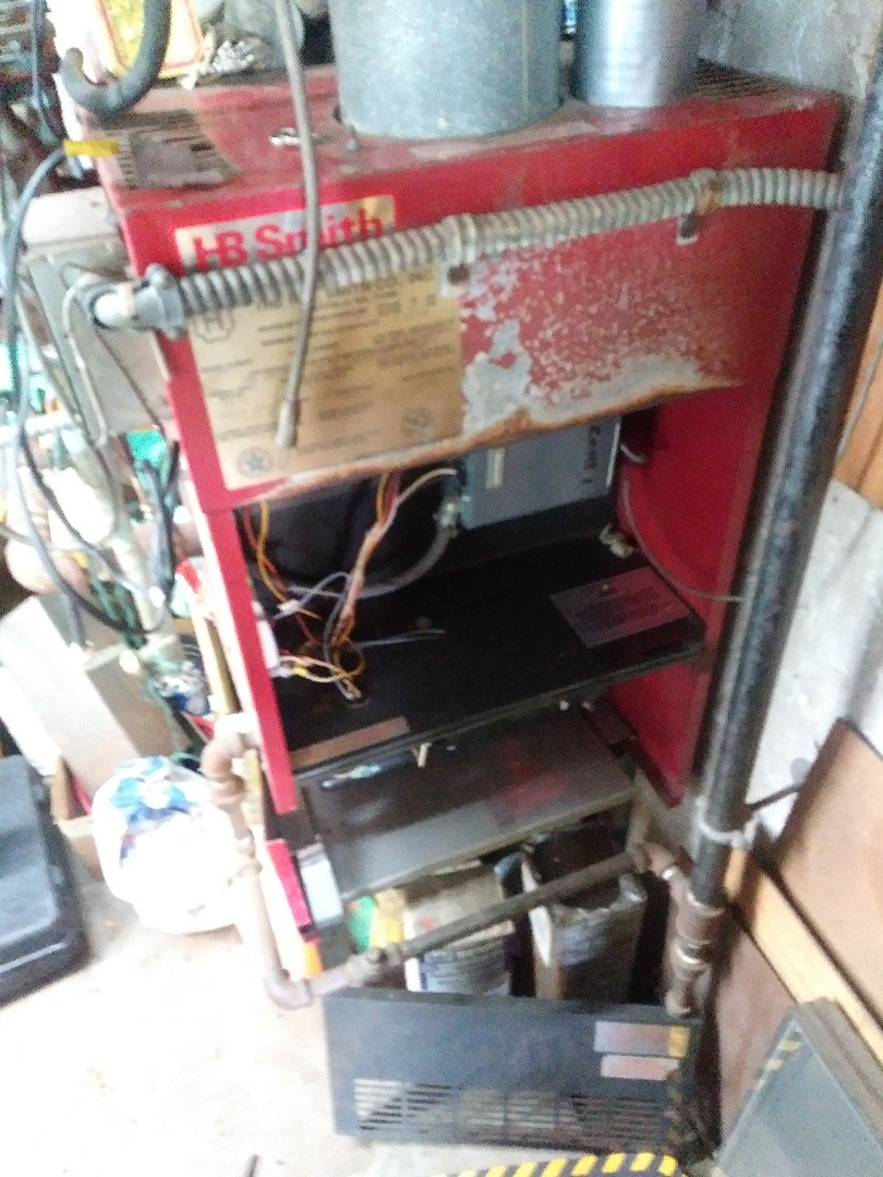 Shrewsbury, MA - Performing heating maintenance on HB Smith boiler