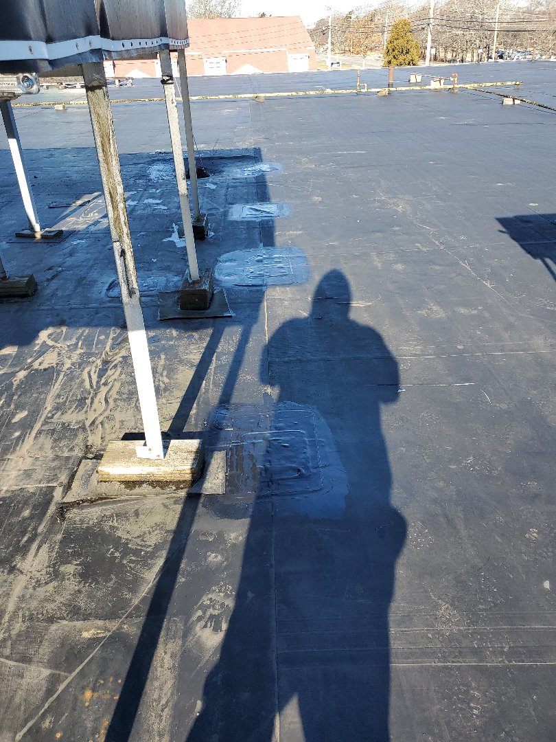 Barnstable, MA - repatched lifting T patches on adhered carlisle rubber roof