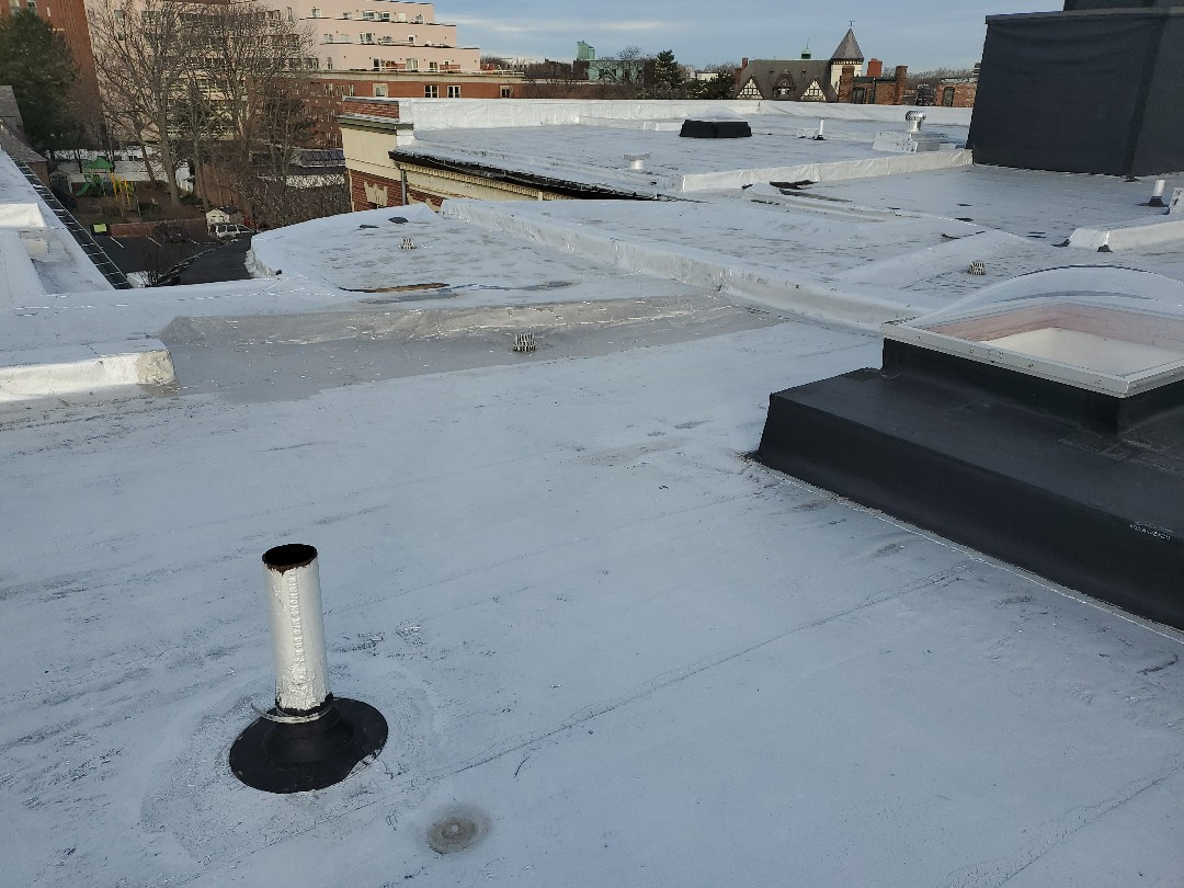 Brookline, MA - aluminum coated roof patched holes and drain with aluminum coat