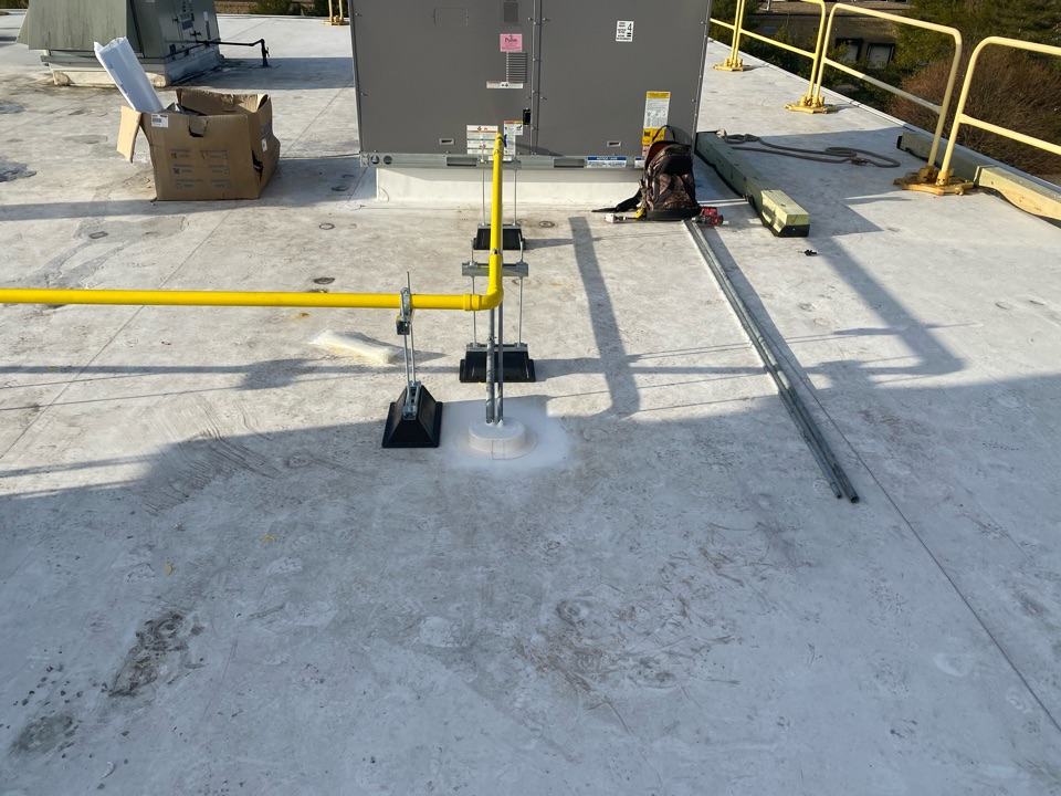 Salem, MA - Installed a TPO pitch pocket on a Carlisle TPO fully adhered system and filled pitch pocket with pourable sealer