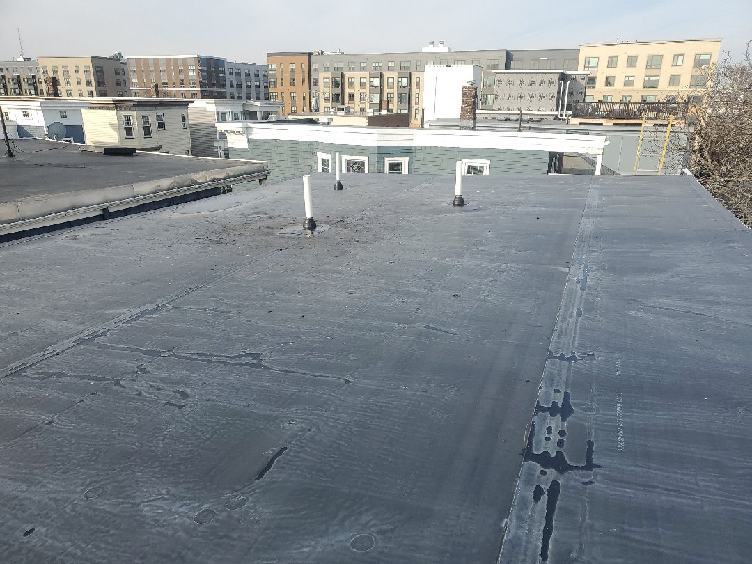 Boston, MA - firestone epdm installed 3 pipe boots.  removed one cast iron