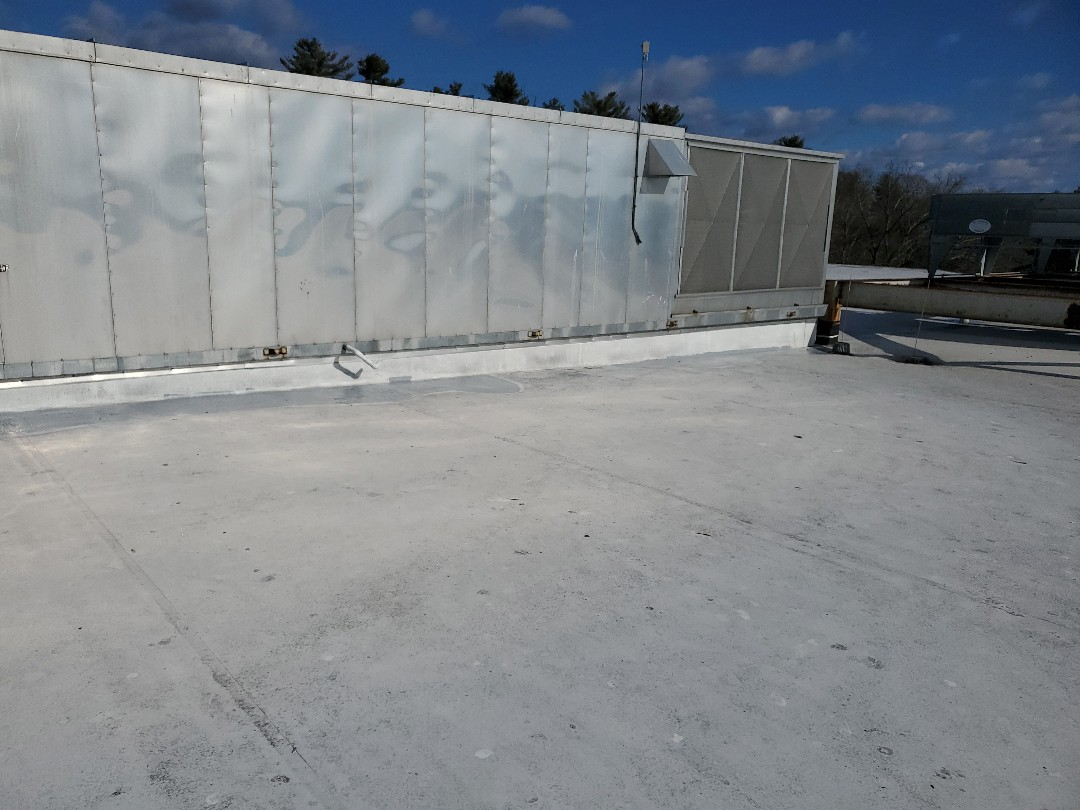 Medway, MA - TPO roof showing scrim and holes patched with gaco