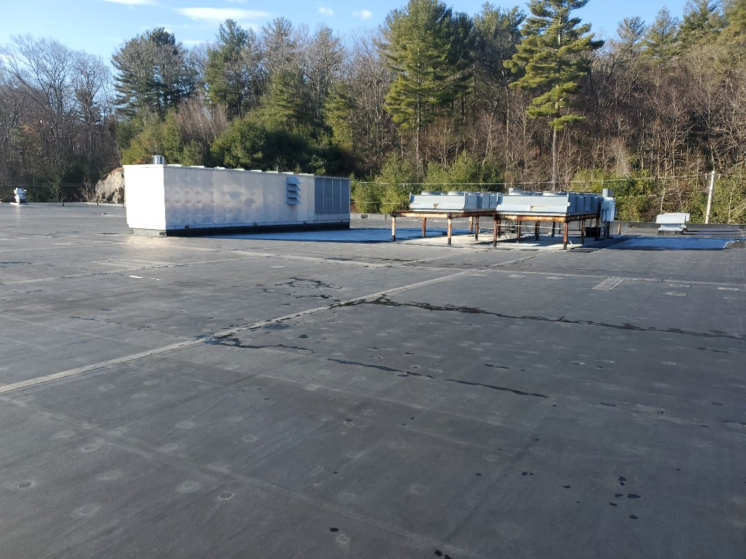 Northbridge, MA - Carlisle EPDM roof patching holes in membrane