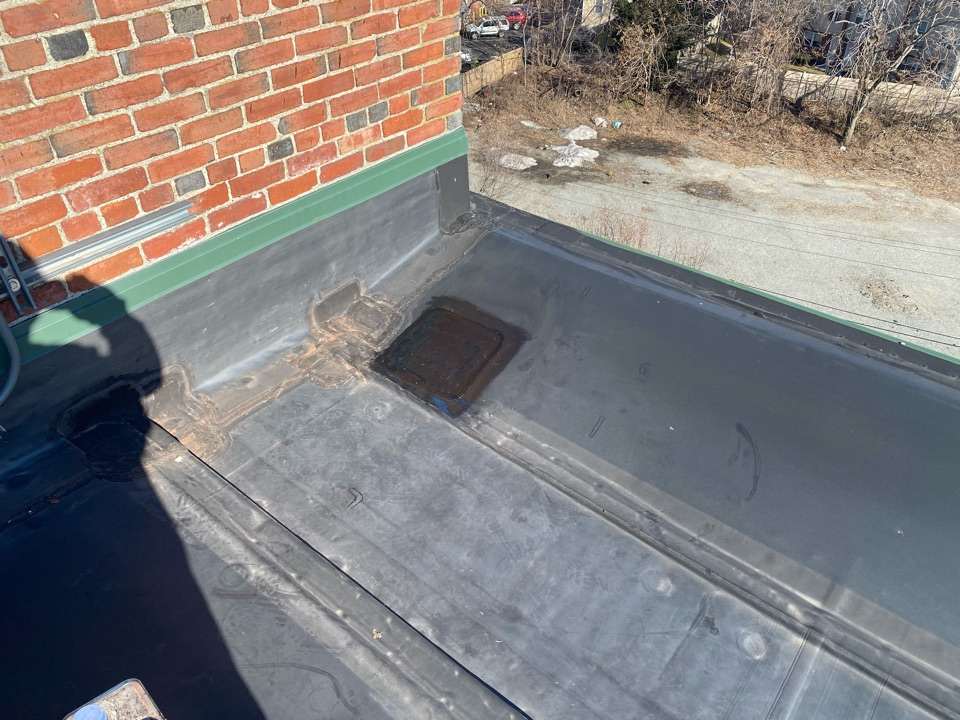 "Lawrence, MA - Found one hole in leak area on a Firestone mechanically fastened roof. Clean and patch with 6"" and 12"" elastoform, and lap sealed"