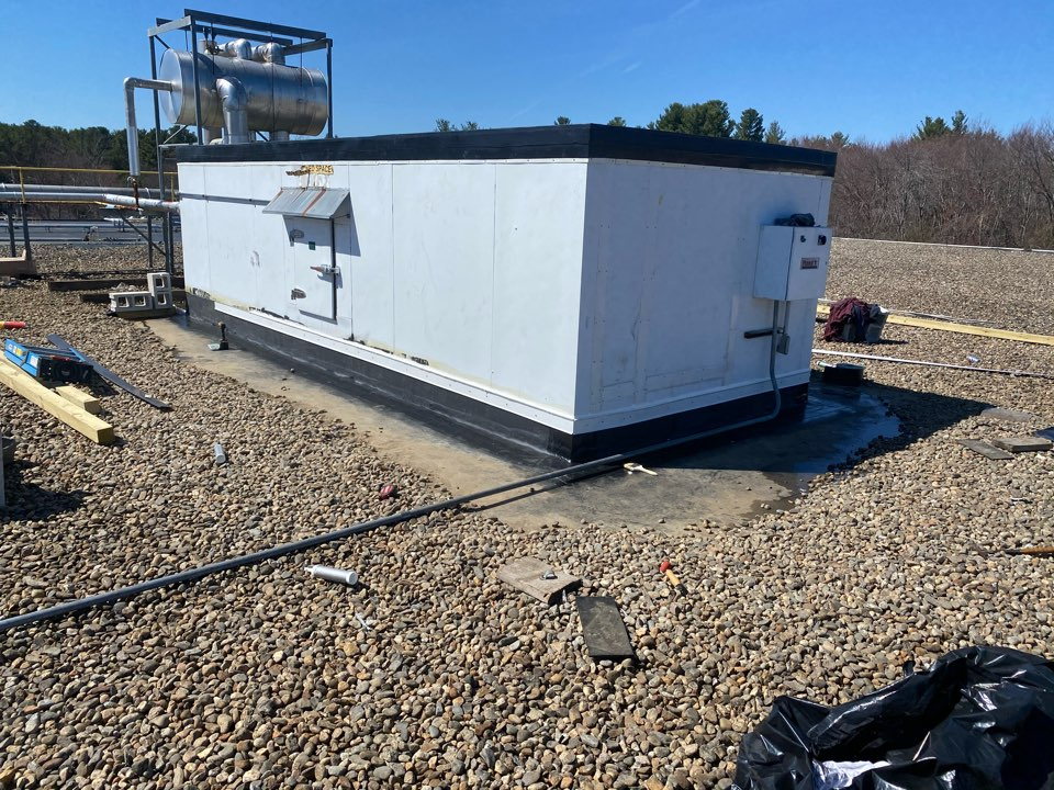 Ayer, MA - Covered top of cooler with peel and stick Firestone EPDM membrane. Re terminated curb do to it was pulling away from unit.