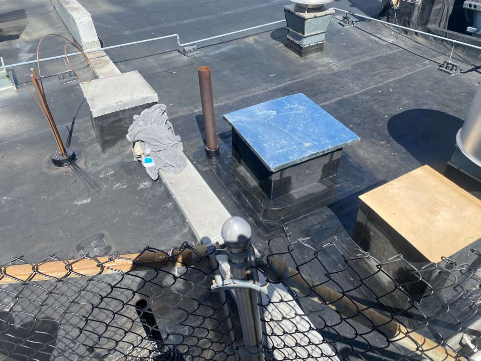 Billerica, MA - Cleaned and Flashed two curbs and installed one pitch pocket on a epdm fully adhered roofing system.