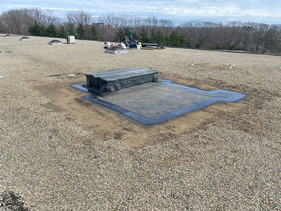 Gloucester, MA - Removed an old existing curb and installed new curb on a tar and gravel roofing system