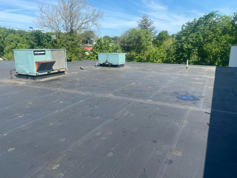 """Warwick, RI - Found one hole in leak area, cleaned, patched with 12"""" elastoform, and until access panel broke and fell off. Re secured  access panel until hvac can fix. On a epdm fully adhered roofing system"""