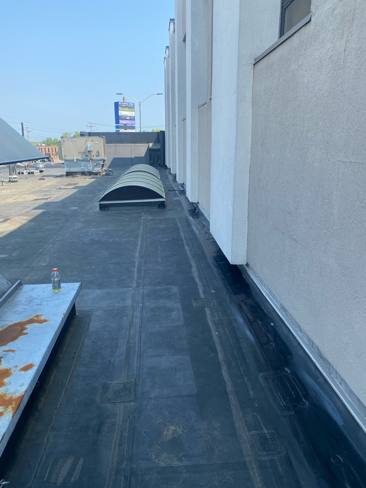 """Braintree, MA - Cleaned, Screwed  and plated perimeter on roof, stripped in with 6"""" on a mechanically fastened roofing system"""