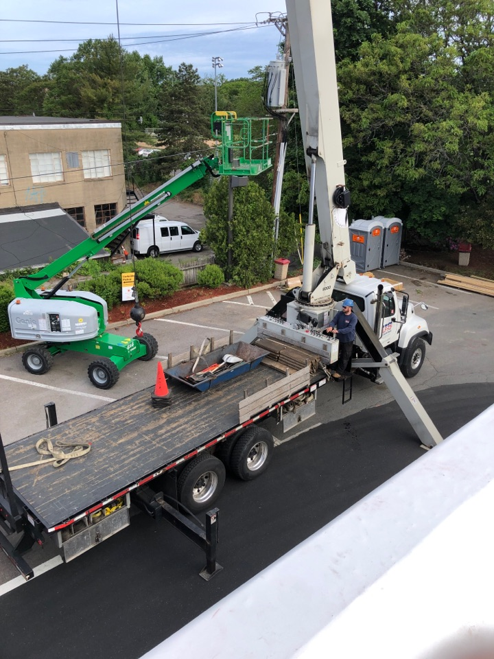 Newton, MA - US Roofing preparing to unload a roof