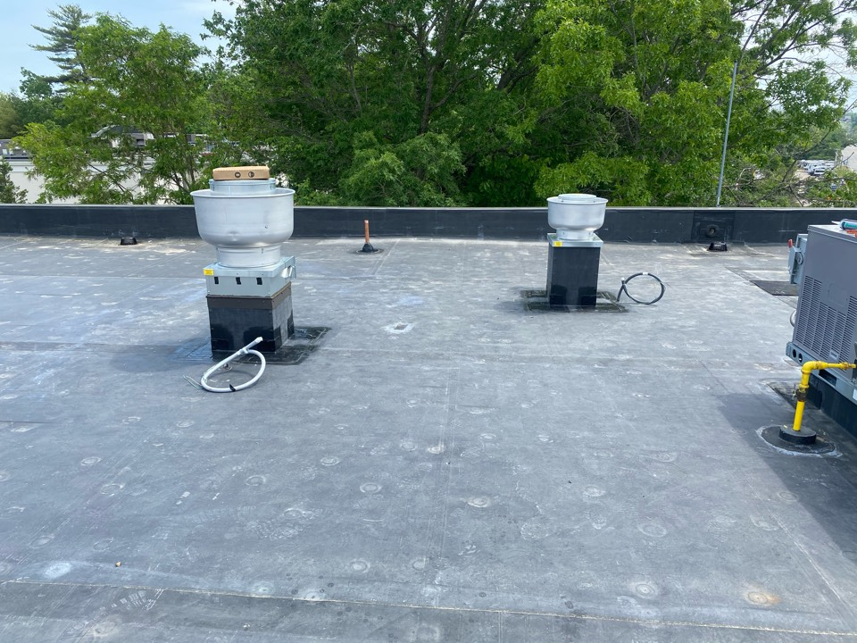 Plainville, MA - Installed two pipe boots and installed two fan curbs on a EPDM fully adhered roofing system