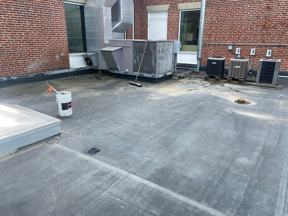 """Boston, MA - Found one hole on a EPDM fully adhered roofing system.  Cleaned with membrane cleaner and patched with 6"""" elastoform"""