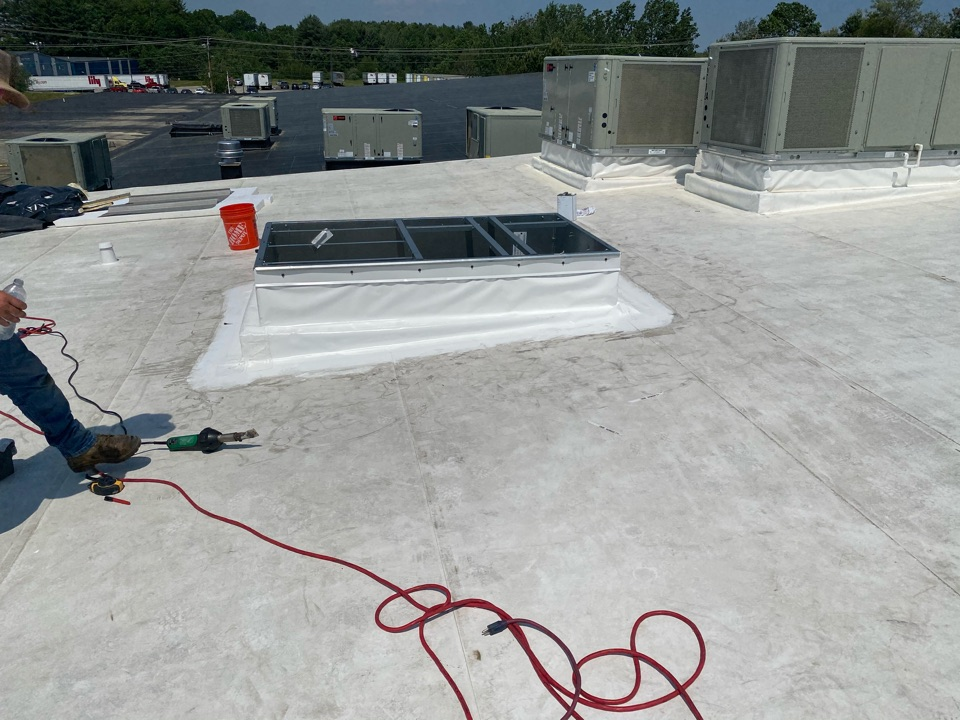 Biddeford, ME - Installed ac unit curb on a pitched durolast roofing system