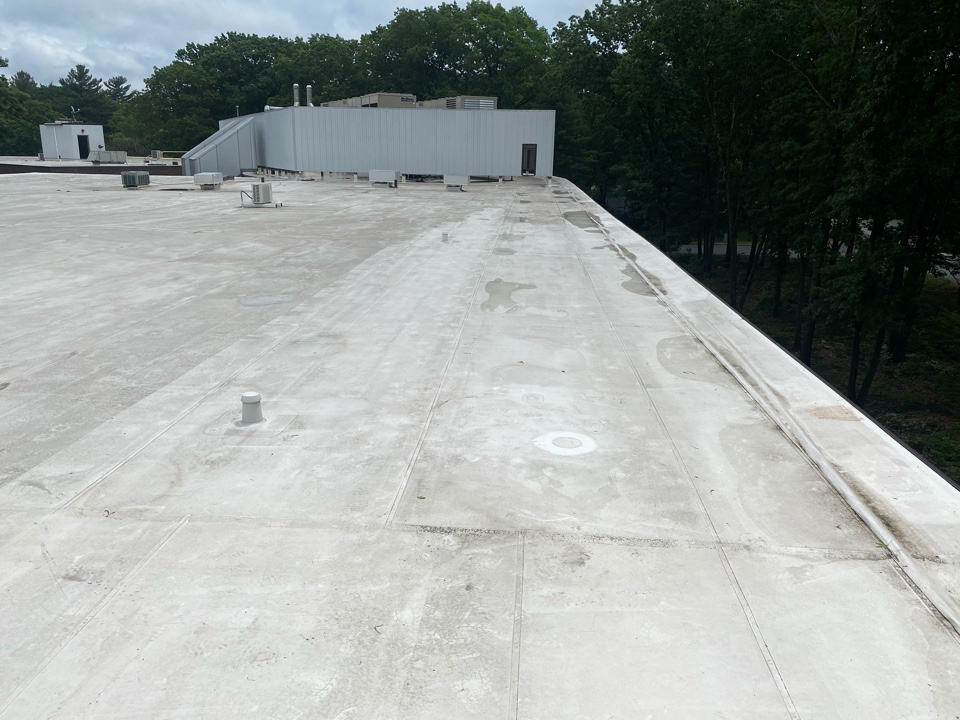 Andover, MA - Patching a hole in leak area. On a Durolast roofing system.