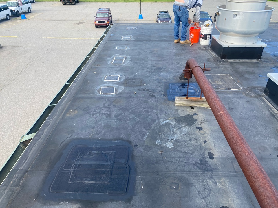 """Salem, MA - Installed metal over 4"""" holes.  Cleaned, patched with 12"""" elastoform, and lapsealed patch on a Carlisle epdm fully adhered roofing system"""
