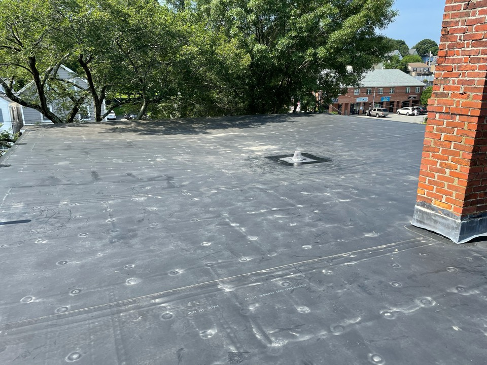 """Salem, MA - Removed 3 copper sleeve inserts, installed one new 4"""" RAC drain, target patched and stripped in on a epdm fully adhered roofing system"""
