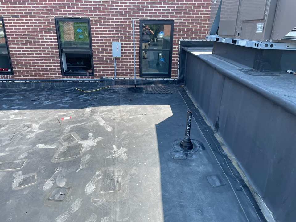 """Salem, MA - Cleaned and installed one epdm pipe boot, patched one hole, and flashed 3/4"""" pvc pipe on a epdm fully adhered roofing system"""
