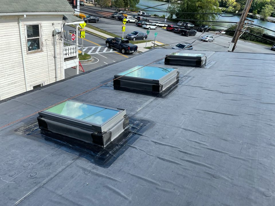 Maynard, MA - Cleaned and stripped in base/seams of skylight due to delamination, lapsealed
