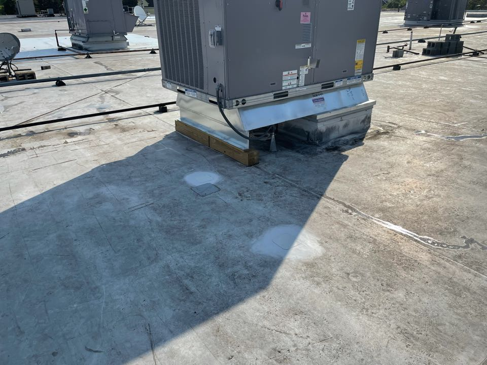 Medford, MA - Cleaned and patched two holes on a mechanically fastened sarnafil roofing system