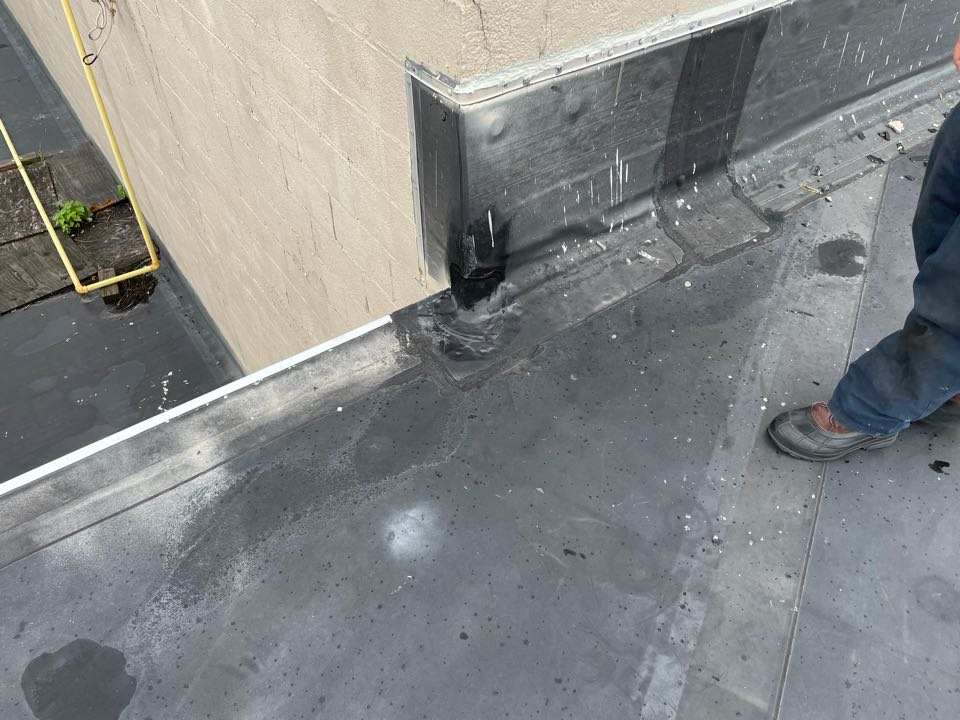 Lynn, MA - Cleaned and patch a hole on a corner of wall on a epdm mechanically fasten roofing system and lap sealed