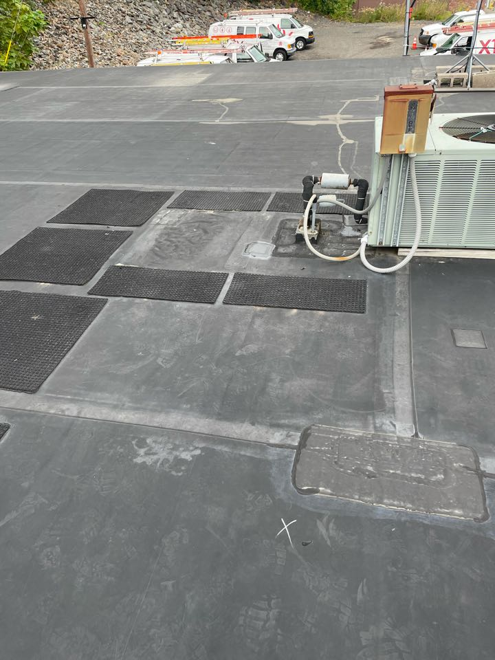 Leominster, MA - Found one hole on a epdm fully adhered. Roofing system.  Cleaned and patched with elastoform, lapsealed