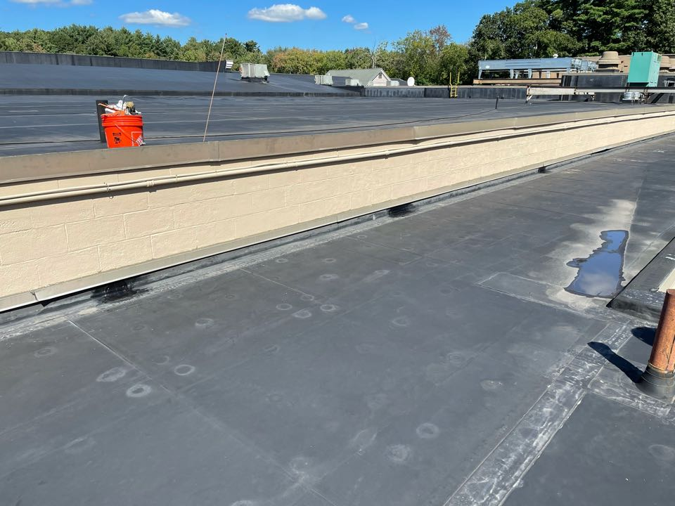 Medfield, MA - Cleaned and patched 3 open vertices on an epdm fully adhered roofing system, lap sealed