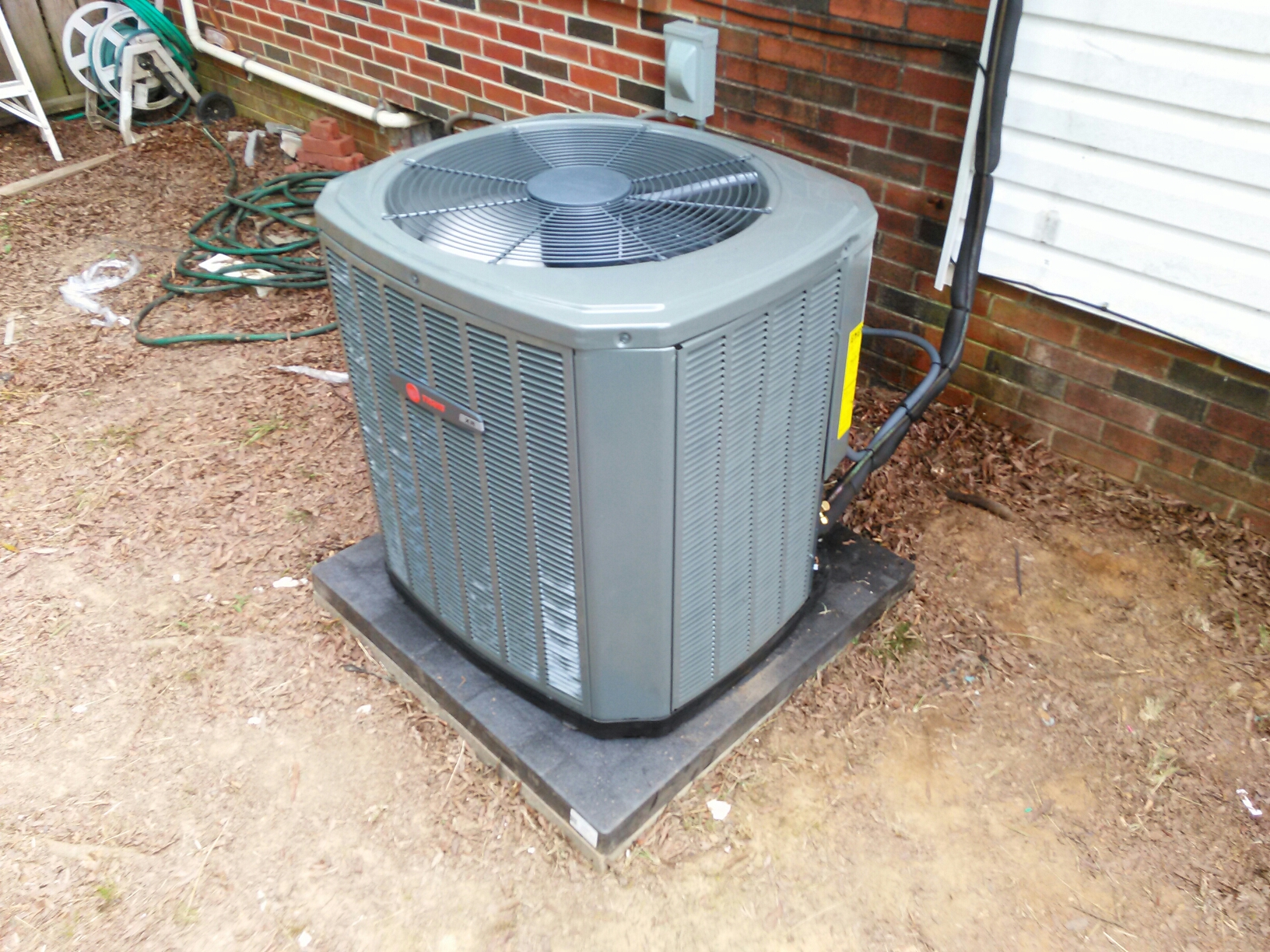 Calhoun, GA - Installing Trane 14 Seer Air Conditioner and Evaporator Coil.