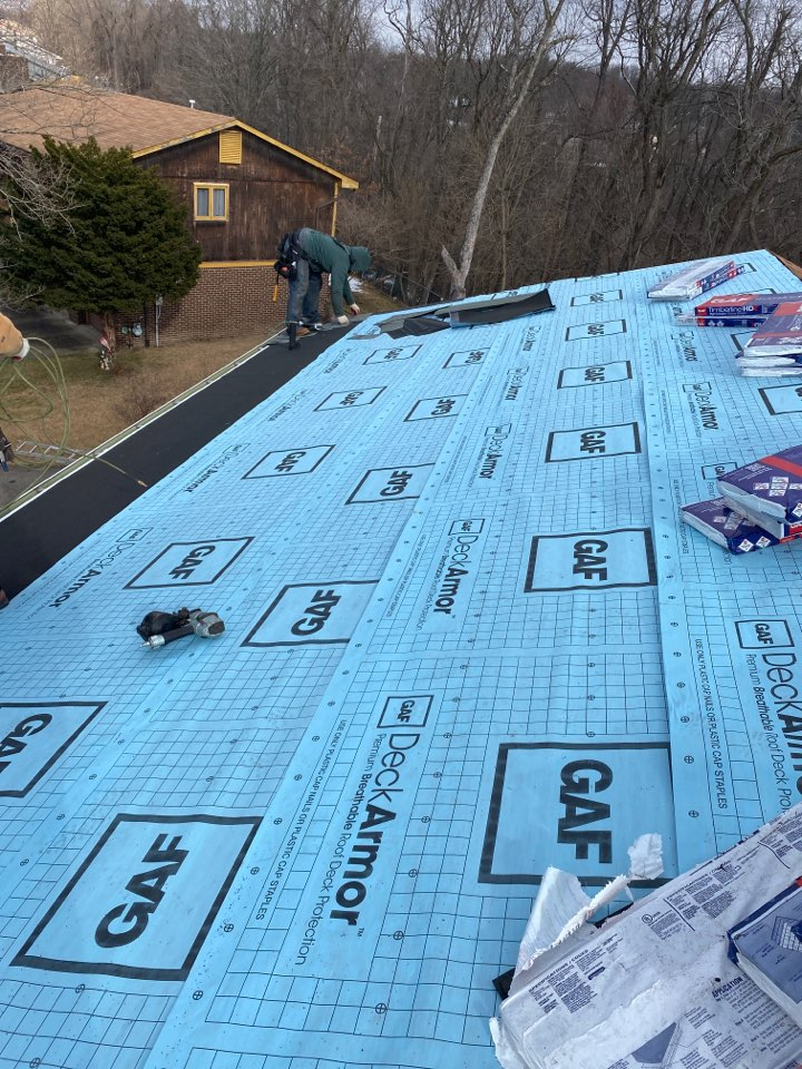 Monroeville, PA - The Best GAF Master Elite Contractor near me installing a Timberline HDZ shingled roof in pewter grey.