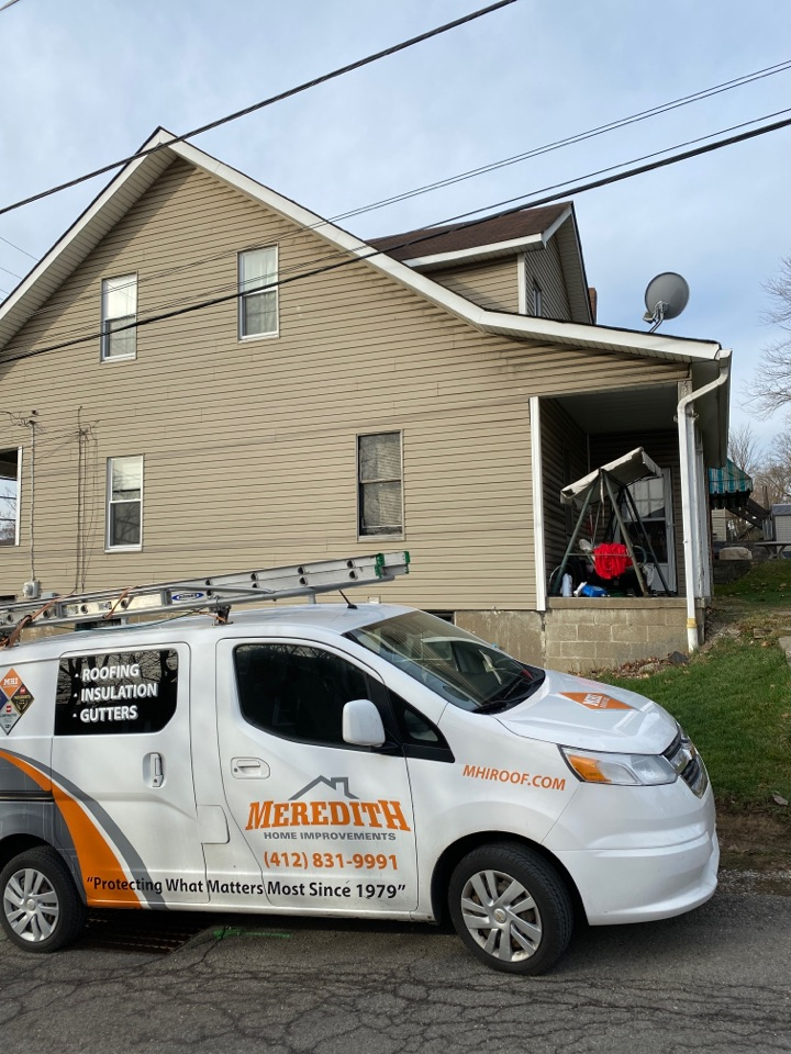 Carnegie, PA - Inspecting a home in Carnegie, Pa for roof replacement as a GAF Master Elite contractor.