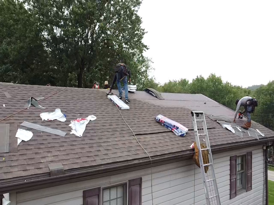 Bethel Park, PA - A beautiful bark wood shingle being installed by MHI roofing!