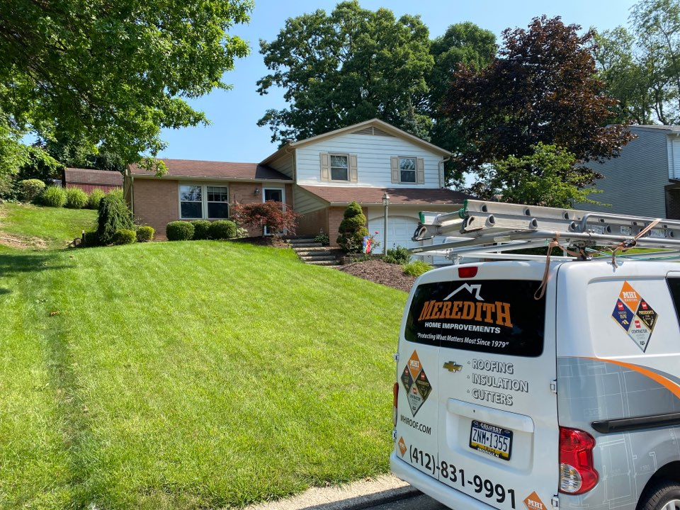 Pittsburgh, PA - Inspecting a home for roof replacement as a GAF Master Elite contractor in Pittsburgh, Pa.