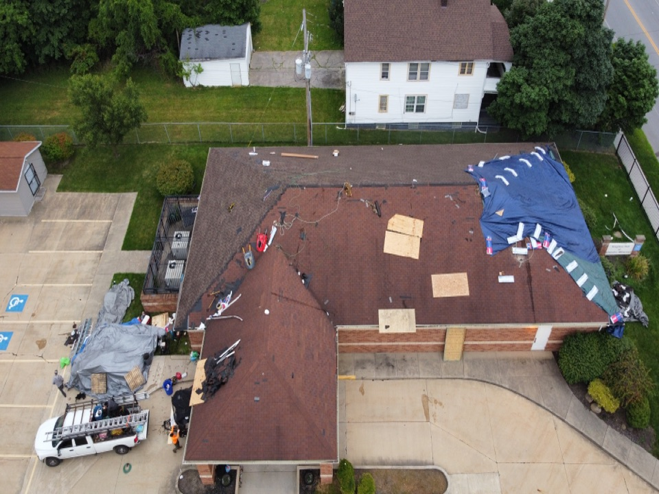 Cleveland, OH - MHI is back to work on day two of our roofing project. Cleveland Ohio's  best Master Elite roofer.