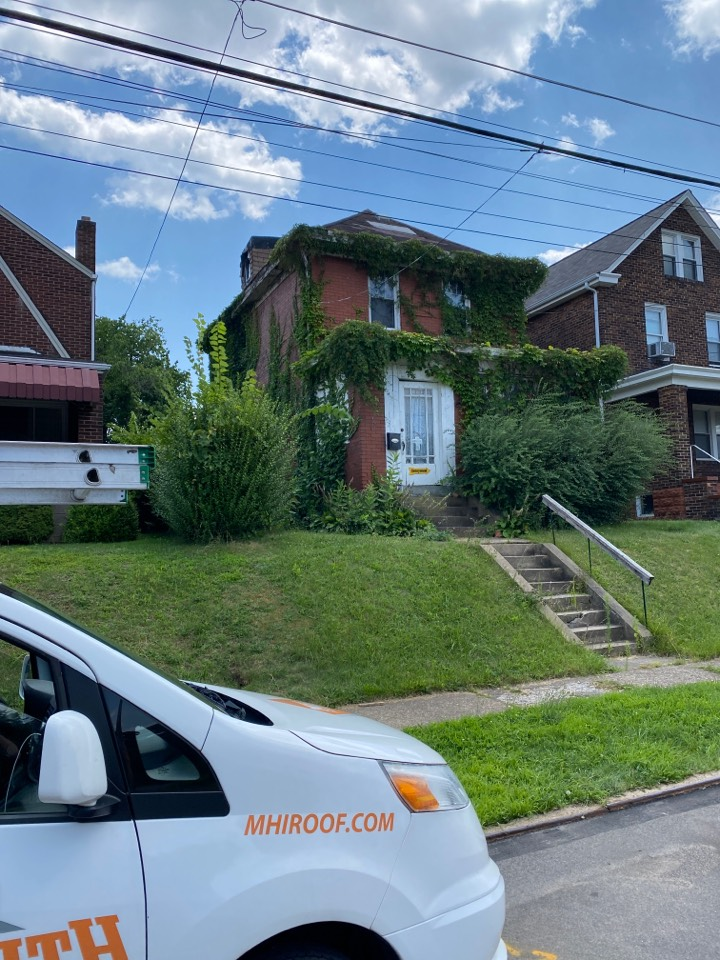 Munhall, PA - Inspecting a home for roof replacement as a GAF Master Elite contractor in Pittsburgh Pa.