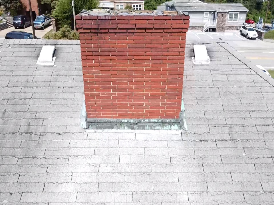 Bethel Park, PA - Inspecting a leaking chimney for MHI roofing! Call us today for your roofing needs