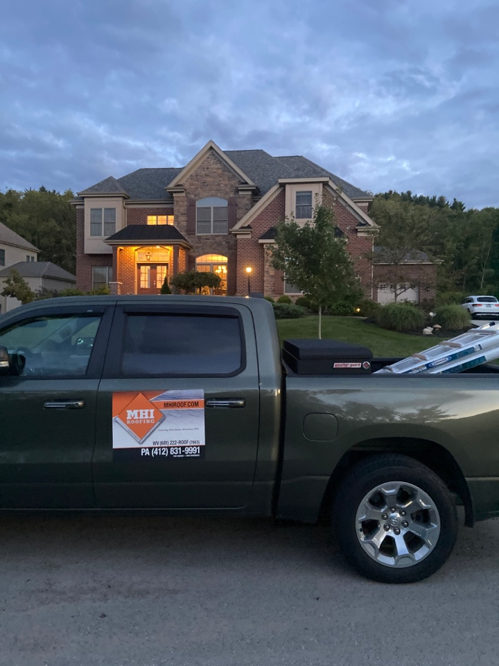 Wexford, PA - GAF Master Elite Contractor in Wexford looking at a roof repair estimate with a couple