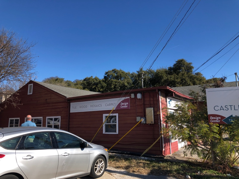 Austin, TX - New roof and siding on commercial building