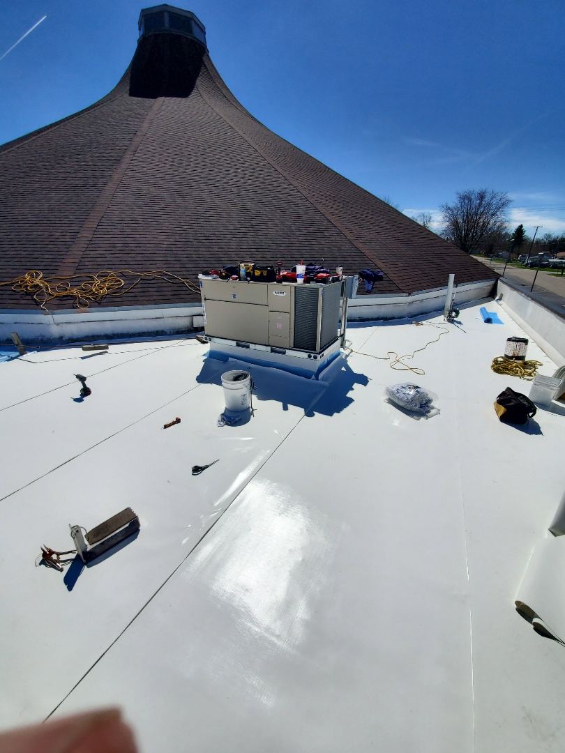 Marion, IN - We are working at New Life Church today in Marion,Indiana. We are installing 50 mill Duro-Last over a silicone coated rubber roof. We are able to lay-over 85% of existing commercial roofs because Duro-Last is mechanically fastened to the roof deck. We dont rely on glue or adhesives to keep our roof system down.