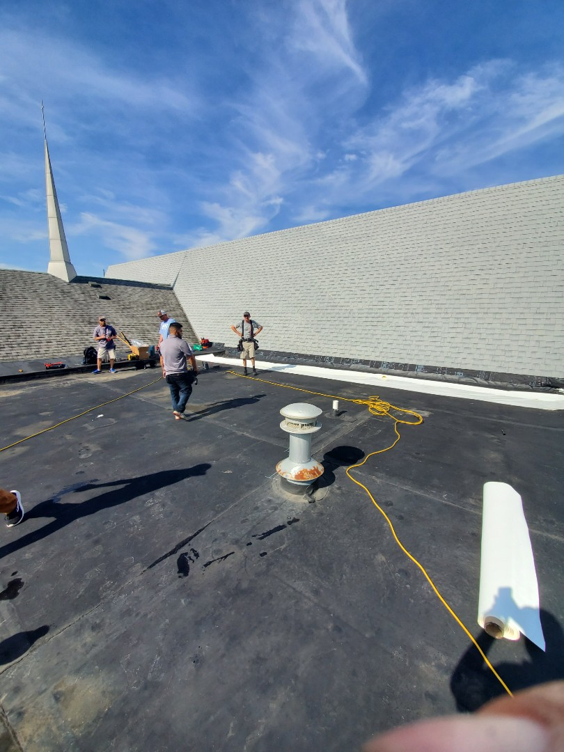 Marion, IN - Installing a new 50 mill Duro-Last roof on Christ Unity church in marion, Indiana. We completed the shingle work 2 weeks ago and we are doing the single-ply roof today. The shingle work was 22/12 pitch.