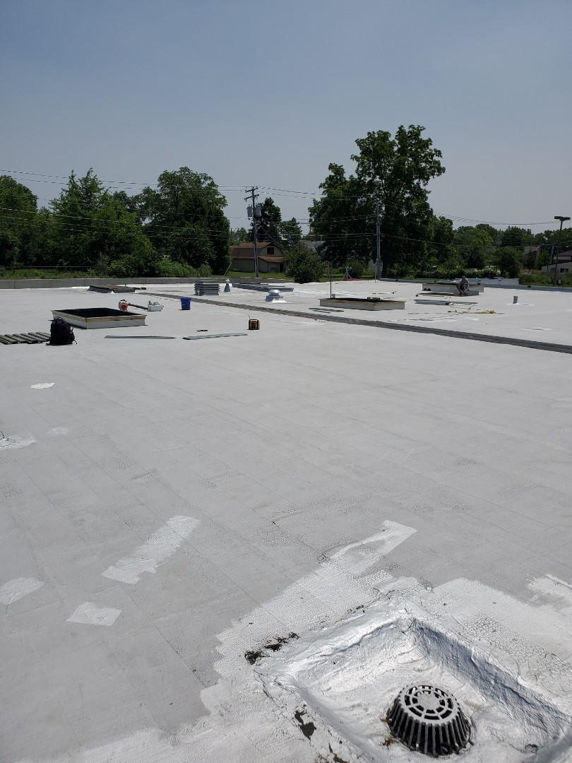 Fort Wayne, IN - Prepping for a 20,000 square foot silicone coating job in Ft. Wayne. We are using Henry Pro-Grade on the existing roof system. There is a 7500 square foot addition being built that will get a fully tapered insulation system and GAF 60 mill TPO single-ply membrane.